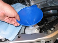 Add coolant as needed to the coolant reservoir, not the radiator.