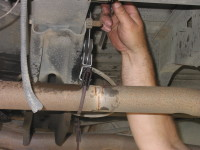 Make sure the exhaust pipe has no holes and that the hangars are in good condition.