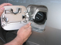 To find matching touch-up paint, remove the fuel fill cover (typically two bolts or screws) and take it with you to an auto paint supply store.